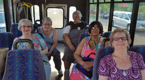 older adults on a transit bus
