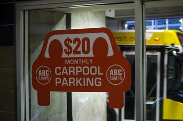 ABC Ramps sign with $20 monthly carpool parking.