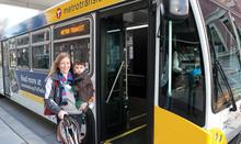 Woman with a small child boarding a bus