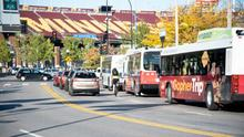 University of Minnesota campus with bike, buses, and cars