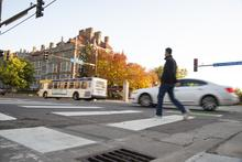 Bus, car, and pedestrian on University Avenue